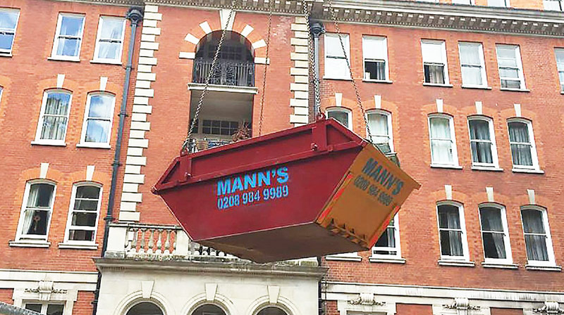 Builders Skip Hire West Ham being lifted onto construction site