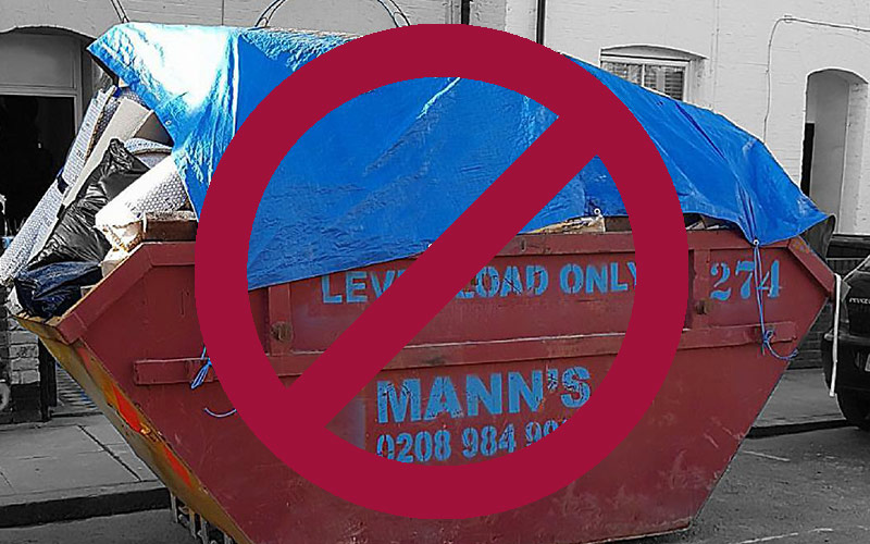 Overloaded Manns Skip Hackney on Road